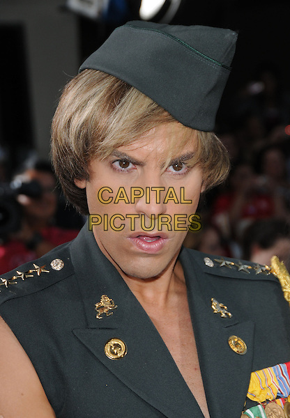"""SACHA BARON COHEN.The Universal Pictures' L.A. Premiere of """"Bruno"""" held at the Grauman's Chinese Theatre in Hollywood, California, USA. .June 25th, 2009.headshot portrait hat army green uniform military mouth open .CAP/DVS.©Debbie VanStory/Capital Pictures."""
