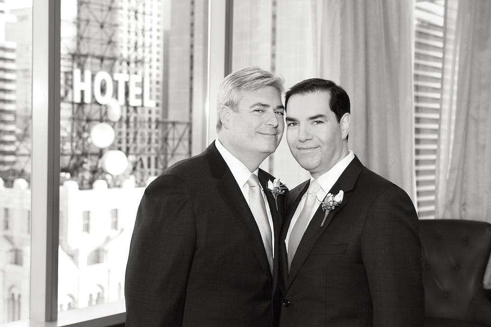 A black & white portrait of two grooms.