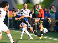 Arturo Alvarez of Earthquakes tries to block Real Salt Lake's Chris Wingert's shot during the game at Buck Shaw Stadium in Santa Clara, California on March 27th, 2010.   Real Salt Lake defeated San Jose Earthquakes, 3-0.
