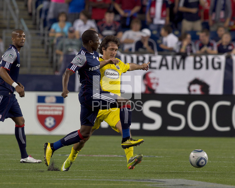New England Revolution midfielder Sainey Nyassi (17) and Columbus Crew forward Guillermo Barros Schelotto (7) battle for the ball. The New England Revolution tied Columbus Crew, 2-2, at Gillette Stadium on September 25, 2010.