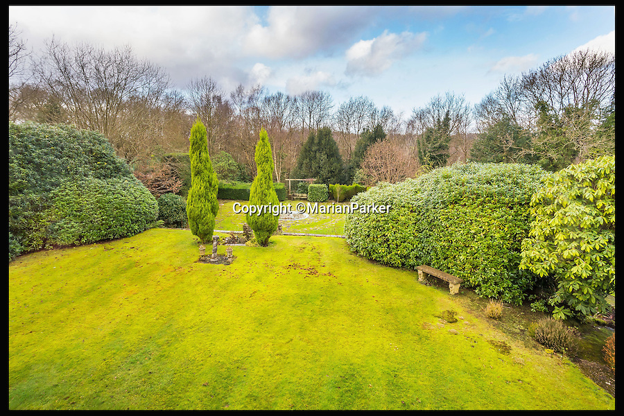 BNPS.co.uk (01202 558833)<br /> Pic: MarianParker/BNPS<br /> <br /> View from the verandah.<br /> <br /> Colonial time capsule - Yours for &pound;1 million.<br /> <br /> The finest original bungalow that remains from Victorian time's is for sale - with a lot more style &amp; grandeur than its hum-drum modern descendents.<br /> <br /> Pleasaunce Cottage in East Grinsted has been meticulously maintained over decades to keep much of its original charm with authentic wood panelling and stained glass windows.<br /> <br /> It is said to be the finest example of a colonial India-style bungalow that exists in this country today and features on the Society for the Protection of Ancient Buildings (SPAB) property list.