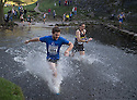 01/11/15<br /> <br /> Video:   https://youtu.be/VybukYfGs1I      .<br /> <br /> <br /> 1,400 runners take on the annual Dovedale Dash. Splashing across the river Dove near Ashbourne, Derbyshire, England, the runners follow a four and three quarter mile muddy, cross-country route through the Derbyshire Dales in The Peak District<br /> <br /> All Rights Reserved: F Stop Press Ltd. +44(0)1335 418365   www.fstoppress.com.