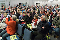 "People gather for a Nuclear Regulatory Commission hearing at Hotel 1620 in Plymouth, Massachusetts, USA, on Tues., Jan. 31, 2017. Pilgrim Station is a nuclear power plant operated by Entergy. An email from the NRC was leaked in December 2016 outlining problems with the ""safety culture"" at the plant and an ""overwhelmed"" staff. Area residents have been calling for the plant to be shut down. The green signs in the audience, reading ""Shut Pilgrim Now,"" are from a group of area residents calling for the plant's closure called Cape Downwinders."