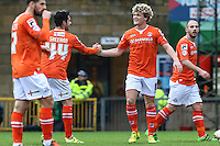 Alan Sheehan of Luton Town (2nd left) congratulates Cameron McGeehan of Luton Town (2nd right) on scoring the opening goal during the Sky Bet League 2 match between Wycombe Wanderers and Luton Town at Adams Park, High Wycombe, England on 6 February 2016. Photo by David Horn.