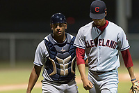 AZL Indians 2 catcher Noah Naylor (12) talks to starting pitcher Carlos Vargas (64) as they walk off the field between innings of an Arizona League game against the AZL Cubs 2 at Sloan Park on August 2, 2018 in Mesa, Arizona. The AZL Indians 2 defeated the AZL Cubs 2 by a score of 9-8. (Zachary Lucy/Four Seam Images)