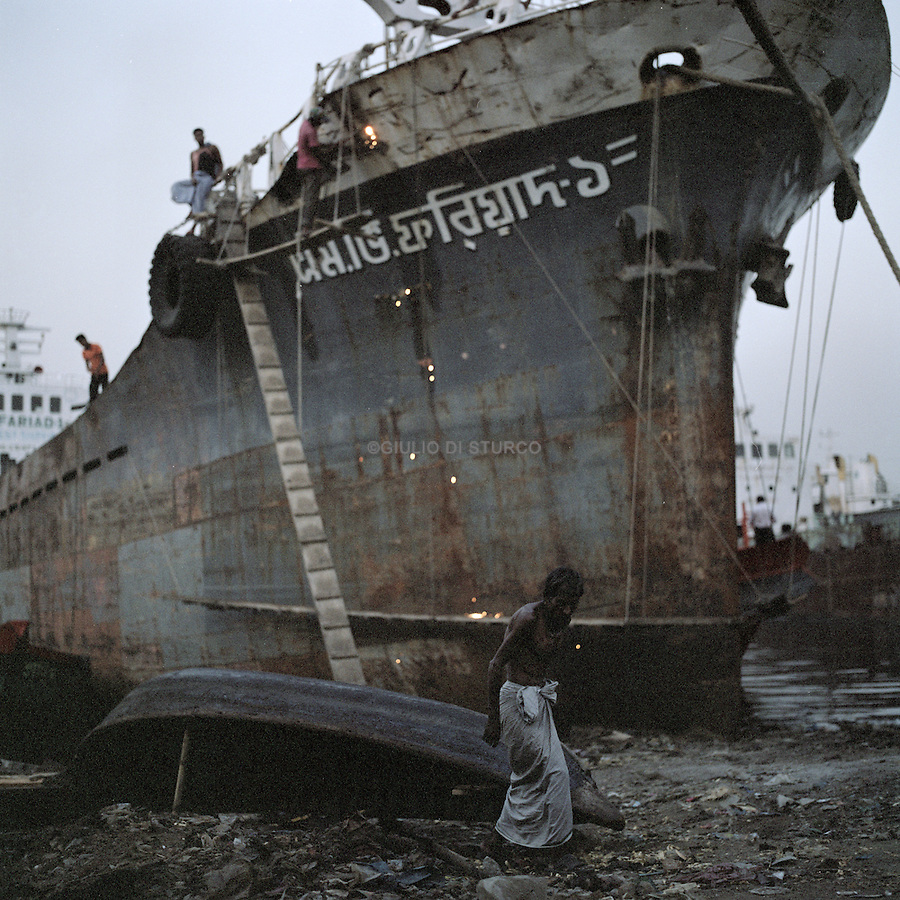 Workers retore big ships that carry cargo and oil in and out of Bangladesh. The ships glide through the sunderbans leaving trails of pollution and waste behind.
