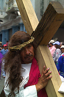 Procesion por  la pasion y muerte de Jesus Cristo durante el Viernes Santo en el centro historico de Quito. Esta peregrinacion reune a miles de personas para presenciar a los fieles llamados cucuruchos y las diversas representaciones del calvario, +religion, iglesia, celebracion, semana, santa*The passion and death of Jesus Christ celebration in the historical center of Quito during Easter. The celebration gathers thousands of pilgrims eager to watch the parade of penitents called cucuruchos and diverse representations of the calvary.+religion, catholic, penitent, faith, faithfull