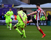 Lincoln City's Luke Waterfall lifts the ball past York City's Shaun Rooney<br /> <br /> Photographer Andrew Vaughan/CameraSport<br /> <br /> Buildbase FA Trophy Semi Final Second Leg - Lincoln City v York City - Saturday 18th March 2017 - Sincil Bank - Lincoln<br />  <br /> World Copyright &copy; 2017 CameraSport. All rights reserved. 43 Linden Ave. Countesthorpe. Leicester. England. LE8 5PG - Tel: +44 (0) 116 277 4147 - admin@camerasport.com - www.camerasport.com