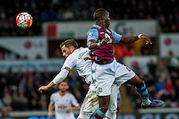 Gylfi Sigurdsson of Swansea City and Aly Cissokho of Aston Villa  battle for the ball during the Barclays Premier League match between Swansea City and Aston Villa played at the Liberty Stadium, Swansea  on March the 19th 2016