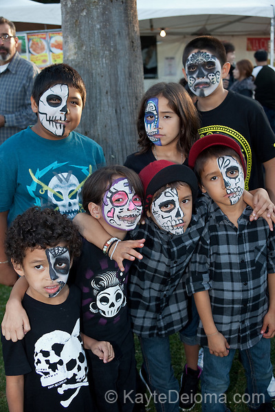 A family painted with calavera face paint at the Dia de Los Muertos celebration at Hollywood Forever Cemetery in Hollywood, CA