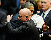 "United States President Barack Obama (L) comforts NASA astronaut Mark Kelly, husband of U.S. Representative Gabrielle Giffords (Democrat of Arizona), at the event ""Together We Thrive: Tucson and America"" honoring the January 8 shooting victims at McKale Memorial Center on the University of Arizona campus on Wednesday, January 12, 2011 in Tucson, Arizona. The memorial service is in honor of victims of the mass shooting at a Safeway grocery store that killed six and injured at least 13 others, including U.S. Representative Gabrielle Giffords (Democrat of Arizona), who remains in critical condition after being shot in the head. Among those killed were U.S. District Judge John Roll, 63; Giffords' director of community outreach, Gabe Zimmerman, 30; and 9-year-old Christina Taylor Green. .Credit: Kevork Djansezian / Pool via CNP"