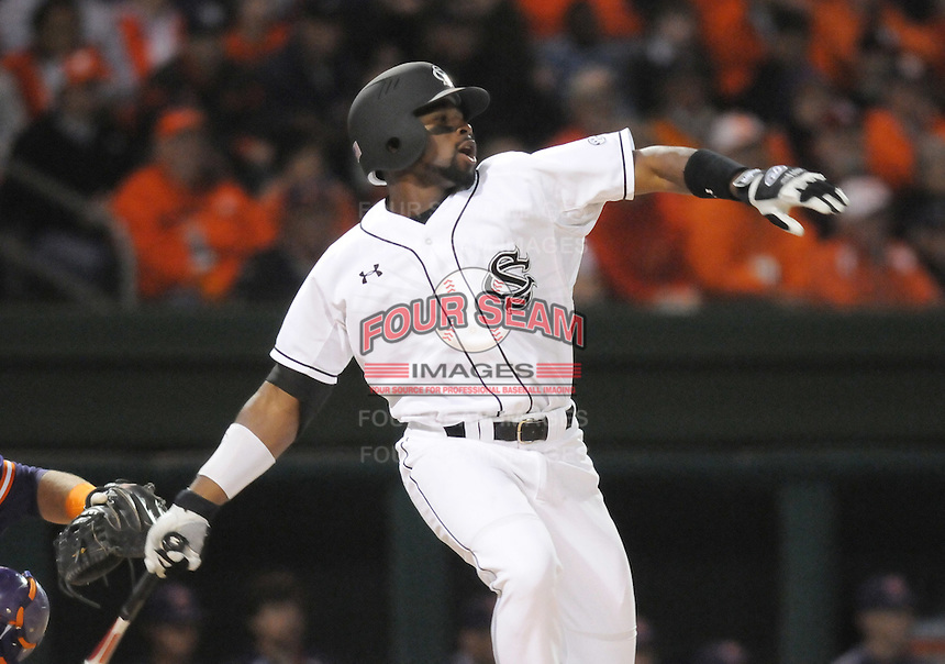 Center fielder Jackie Bradley Jr. (19) of the South Carolina Gamecocks hits during the first inning against the Clemson Tigers on Tuesday, March 8, 2011, at Fluor Field in Greenville, S.C. South Carolina won 5-4. Photo by Tom Priddy / Four Seam Images
