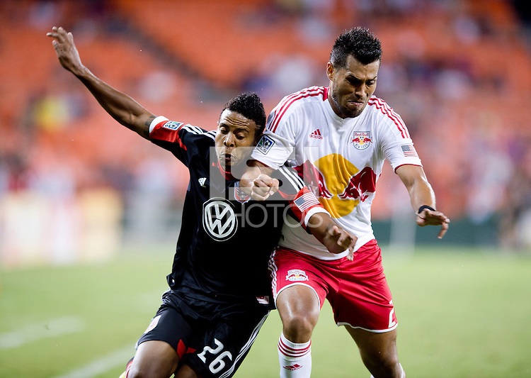 Lionard Pajoy (26) of D.C. United fights for the ball with Wilman Conde (2) of the New York Red Bulls during the game at RFK Stadium in Washington, DC.  D.C. United tied the New York Red Bulls, 2-2.