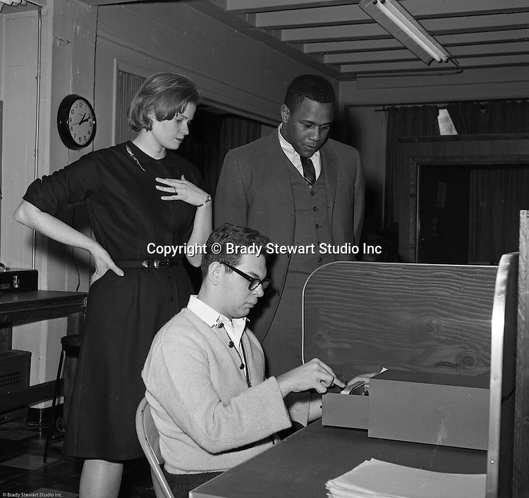 Pittsburgh PA:  Willie Stargell getting a tour of the Goodwill Industries facility - 1966.  Willie and a many other Pittsburgh Pirates were very involved in the community supporting charitable causes.  <br /> In 1966, Goodwill Industries was part of the United Fund Community Chest Agency which eventually became the United Way of Allegheny County in 1974. Goodwill Industries provides a broad array of employment-related education and workforce development programs and services for people with physical and intellectual disabilities and other barriers to employment.