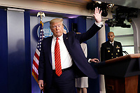 United States President Donald J. Trump waves after a press briefing on the Coronavirus COVID-19 pandemic with members of the Coronavirus Task Force at the White House in Washington on March 19, 2020.<br /> Credit: Yuri Gripas / Pool via CNP/AdMedia