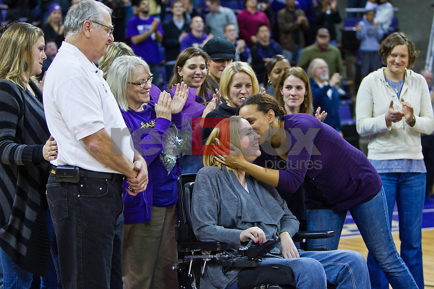 The Huskies honored former letterwinner Melissa Erickson during an emotional halftime ceremony on Wednesday. Erickson is currently battling ALS, more commonly known as Lou Gehrig's disease. The Littleton, Colo., native was joined on the court by her family and teammates, and was given a standing ovation. -- The University of Washington Huskies women's basketball team defeats the Seattle University Redhawks 72-53 at Hec Ed Pavilion at Alaska Airlines Arena Wednesday, Nov. 16, 2011. (Photo by Andy Rogers/Red Box Pictures)