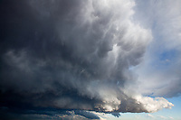 Cumulonimbus clouds billow along the Front Range, Colorado.