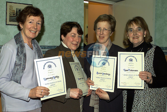 Rosemarie Reilly, patrick Street, margaret Hughes, Dundalk, Ann Pentony Tullyallen and Rose Coleman Dundalk who received there certificates from Minister Dermot Ahern TD in the Community services centre..Pic Fran Caffrey Newsfile