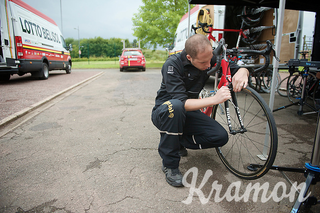 mechanic Frederik Moons (BEL) getting the bikes prepped for the much anticipated 'Roubaix-stage' the next day<br /> <br /> 2014 Tour de France<br /> stage 4: Le Touquet-Paris-Plage/Lille Métropole (163km)