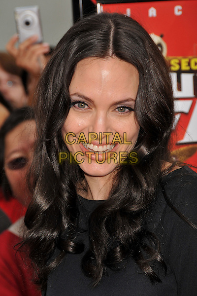 """ANGELINA JOLIE.""""Kung Fu Panda"""" and """"Secrets of the Furious Five"""" DVD Release at Grauman's Chinese Theatre, Hollywood, California, USA, 09 November 2008..portrait headshot  black wavy hair smiling .CAP/ADM/BP.©Byron Purvis/Admedia/Capital PIctures"""