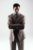 Caucasian looking man wearing a tan suit facing forward