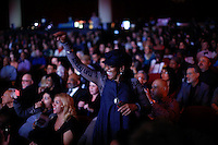 New York, United States. 23th March 2014 - A woman dances during a special concert to commemorate the life and legacy of Celia Cruz at the Apollo theater in Harlem, New York. Photo by Eduardo Munoz Alvarez/VIEW