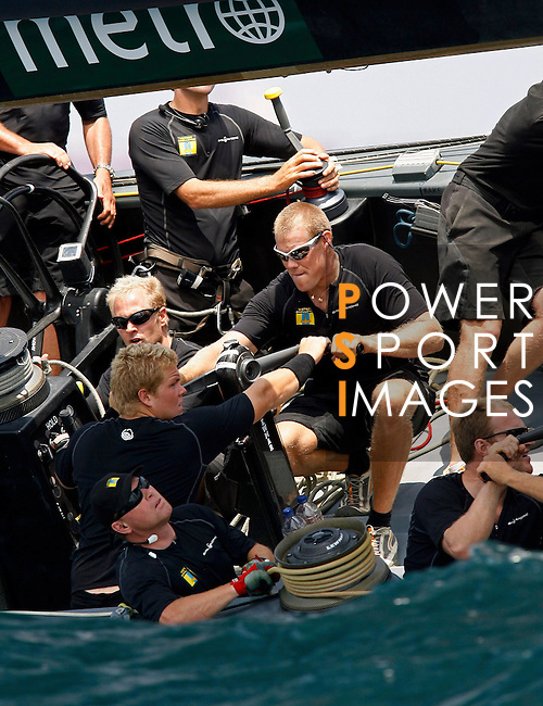 28 May 2006, Valencia, Spain --- Crew members of America's Cup challenger Victory Challenge of Sweden work on the boat during their match-race against Areva Challenge of France at the Louis Vuitton Act 12 in Valencia, eastern Spain. Photo by Victor Fraile / The Power of Sport Images