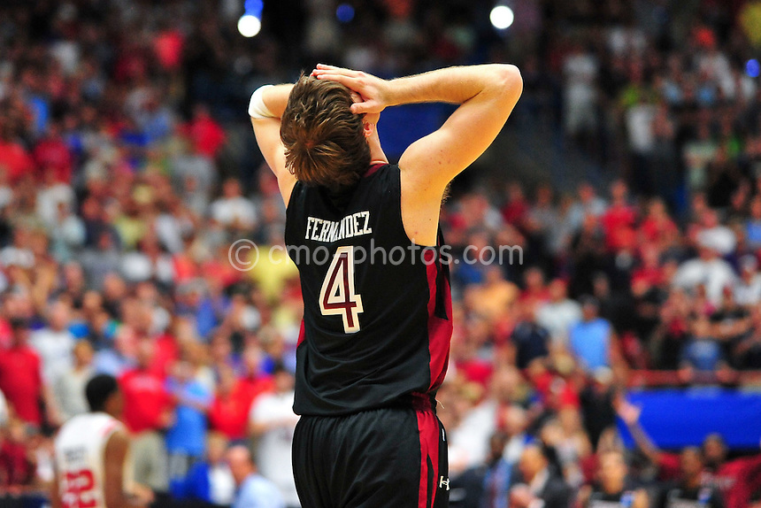 Mar 19, 2011; Tucson, AZ, USA; Temple Owls guard Juan Fernandez (4) reacts in the second half of a game against the San Diego State Aztecs in the third round of the 2011 NCAA men's basketball tournament at the McKale Center.  The Aztecs won 71-64.