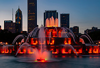 Buckingham Fountain glows red at dusk during it nightly simmer light and water show on Chicago's Lake Michigan waterfront, Chicago, Illinois
