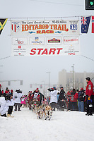 Aliy Zirkle and team leave the ceremonial start line at 4th Avenue and D street in downtown Anchorage during the 2013 Iditarod race. Photo by Jim R. Kohl/IditarodPhotos.com