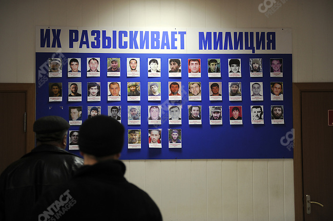 In a police station in Mahachkala, the Dagestan capital, men looked at the portraits of extremists on the police wanted list. January 28, 2010