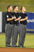 Umpires Brent Rice, Jordan Ferrell and Spencer Flynn take hats off for the singing of God Bless America during the Southern League All-Star Game  at Smokies Park on June 19, 2012 in Kodak, Tennessee.  The South Division defeated the North Division 6-2. (Tony Farlow/Four Seam Images).