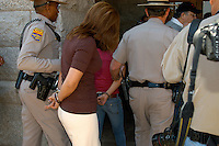 "Protesting the SB1611 at the State Capitol in Phoenix, AZ A mother (Alma Sotelo cq) and her 15 year old Daughter are arrested for chanting ""No Mas"" during the hearing while State Senator Kyrsten Sinema (cq) was speaking on Tuesday, February 22, 2011."