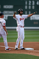 First baseman Devlin Granberg (17) of the Greenville Drive gestures to the dugout after hitting a triple in a game against the Hickory Crawdads on Wednesday, May 15, 2019, at Fluor Field at the West End in Greenville, South Carolina. Greenville won, 6-5. (Tom Priddy/Four Seam Images)