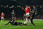Marcus Rashford of Manchester United is challenged by Mamadou Sakho and Nathaniel Clyne of Liverpool during the UEFA Europa League match at Old Trafford. Photo credit should read: Philip Oldham/Sportimage