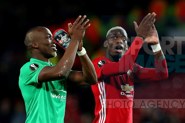 Florentin Pogba of Saint Etienne holds personalised shin pads as he applauds the crowd with brother Paul Pogba during the UEFA Europa League Round of 32 1st leg match at Old Trafford Stadium, Manchester. Picture date: February 16th, 2017. Pic credit should read: Matt McNulty/Sportimage