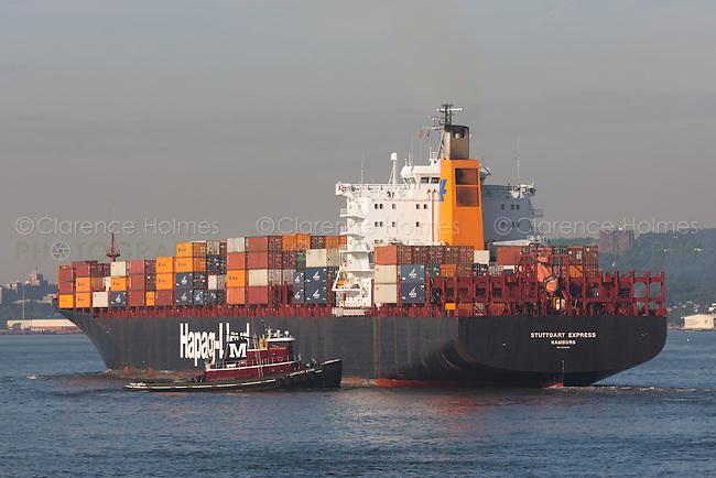Cargo ship Stuttgart Express in New York Harbor assisted by tugboat Margaret Moran.