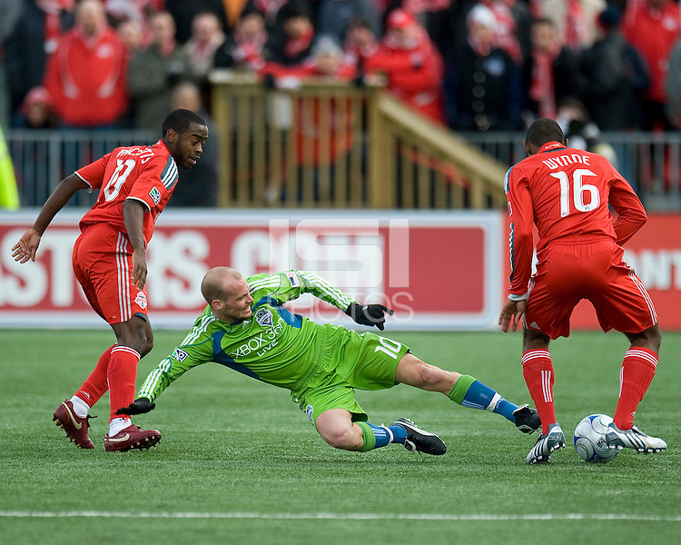 Freddie Ljungberg (10) of the Seattle Sounders FC attempts a slide tackle on Marvell Wynne (16) of the Toronto FC during MLS action at BMO Field on April 4, 2009.Seattle won 2-0.