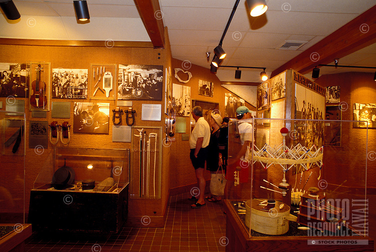 Visitors view photos and artifacts at the Whalers Village Museum in Kaanapali