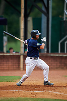 Elizabethton Twins first baseman Chris Williams (40) follows through on a swing during a game against the Bristol Pirates on July 29, 2018 at Joe O'Brien Field in Elizabethton, Tennessee.  Bristol defeated Elizabethton 7-4.  (Mike Janes/Four Seam Images)