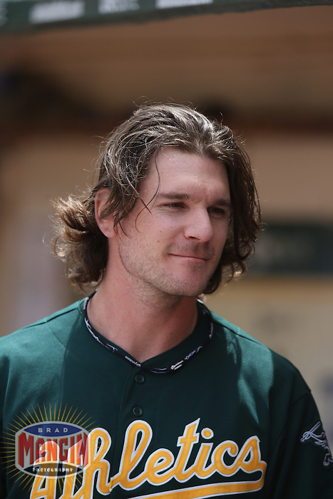 OAKLAND, CA - MAY 15:  John Jaso #5 of the Oakland Athletics stands in the dugout during the game against the Texas Rangers at O.co Coliseum on Wednesday May 15, 2013 in Oakland, California. Photo by Brad Mangin