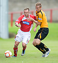 Brechin's Johnny Stewart and Alloa's Robert Thomson challenge for the ball ...