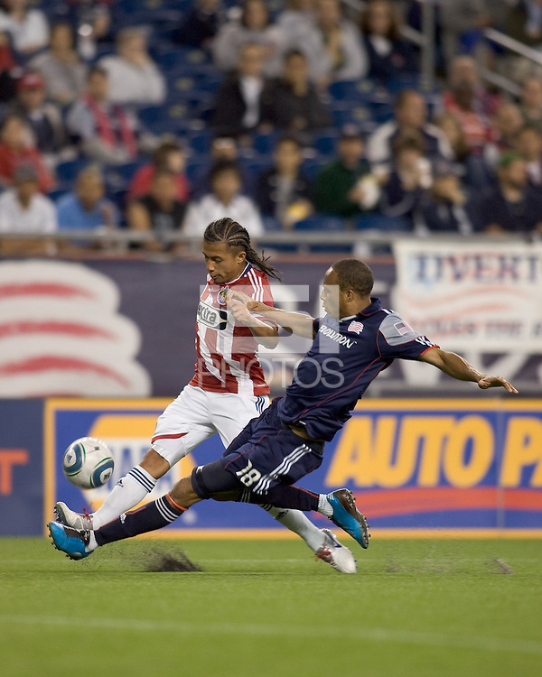 New England Revolution forward Khano Smith (18) tackles Chivas USA midfielder Gerson Mayen (14). Chivas USA defeated the New England Revolution, 4-0, at Gillette Stadium on May 5, 2010.