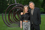 Becca Thrash and sculptor Bernar Venet at the Art in the Park benefit at Thrash's home Wednesday May 20,2009.(Dave Rossman/For the Chronicle)