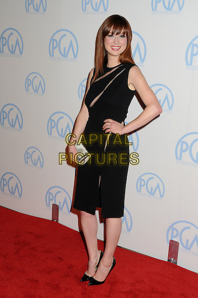 Ellie Kemper.23rd Annual Producers Guild Awards held at the Beverly Hilton Hotel, - Beverly Hills, California, USA, .21st January 2012..sleeveless black dress hand on hip slit slits cut out clutch bag full length .CAP/ADM/BP.©Byron Purvis/AdMedia/Capital Pictures.