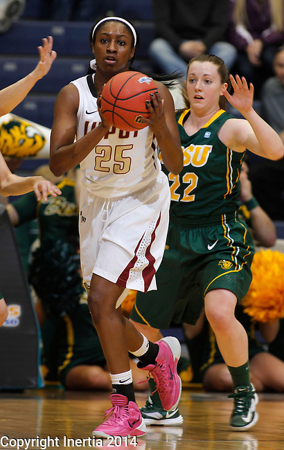 SIOUX FALLS, SD - MARCH 8:  Deairra Goss #25 of IUPUI passes in front of North Dakota State defender Bree Whatman #22 during their quarterfinal game at the 2014 Summit League Basketball Championships at the Sioux Falls Arena. (Photo by Ty Carlson/Inertia)