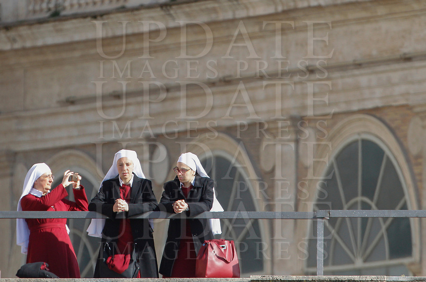 Nuns wait for the start of the Pope's Easter Mass in St. Peter's Square at the Vatican, April 1, 2018.<br /> UPDATE IMAGES PRESS/Riccardo De Luca<br /> <br /> STRICTLY ONLY FOR EDITORIAL USE