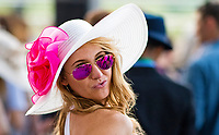 ELMONT, NY - JUNE 10: A woman poses for the camera while wearing a fancy hat on Belmont Stakes Day at Belmont Park on June 10, 2017 in Elmont, New York (Photo by Scott Serio/Eclipse Sportswire/Getty Images)