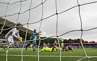 Chris Porter of Colchester United scores his goal past Goalkeeper Scott Brown of Wycombe Wanderers during the Sky Bet League 2 match between Wycombe Wanderers and Colchester United at Adams Park, High Wycombe, England on 27 August 2016. Photo by Andy Rowland.