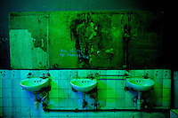 Sinks of the men's rest rooms of The Shrine, a famous nightclub home of Fela Kuti's son Femi, in Nigeria's capital Lagos on Saturday night April 2  2009..The club was home to the king of Afrobeat, Fela Anikulapo Kuti, who died in 1997 from Aids-related reasons..For more than two decades Fela performed at the shrine with the same incredible energy with which he enjoyed drugs and women..The shrine - then a dingy club on the outskirts of Lagos that became a legend - closed soon after Fela's death.